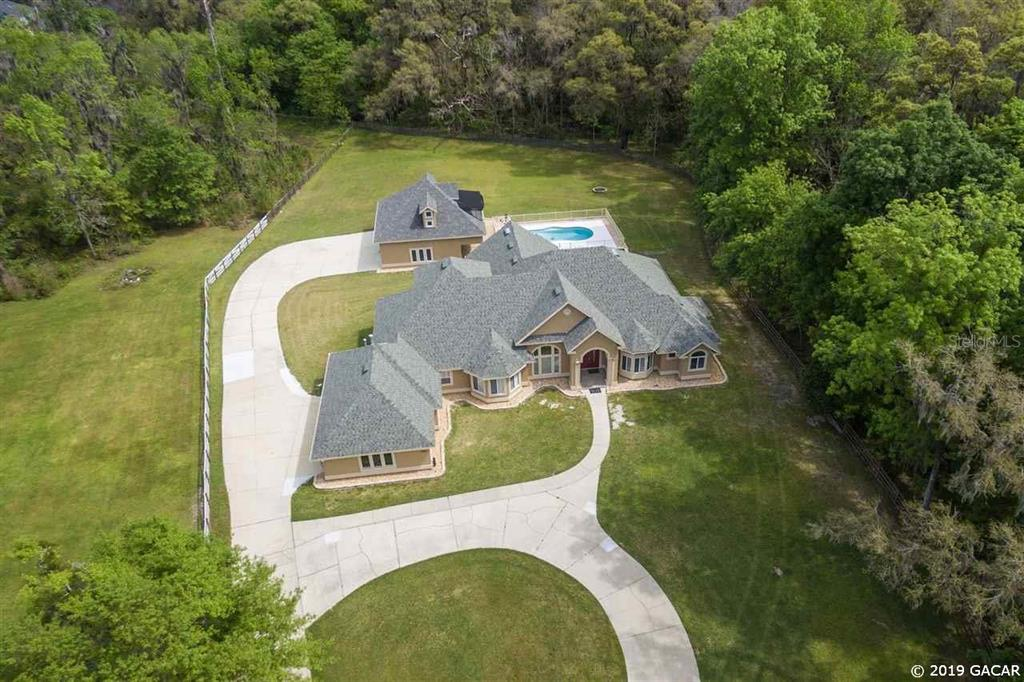 1451 104th DRIVE, Gainesville, Florida 32606, 6 Bedrooms Bedrooms, ,4 BathroomsBathrooms,Residential,For Sale,104th,MFRGC422028